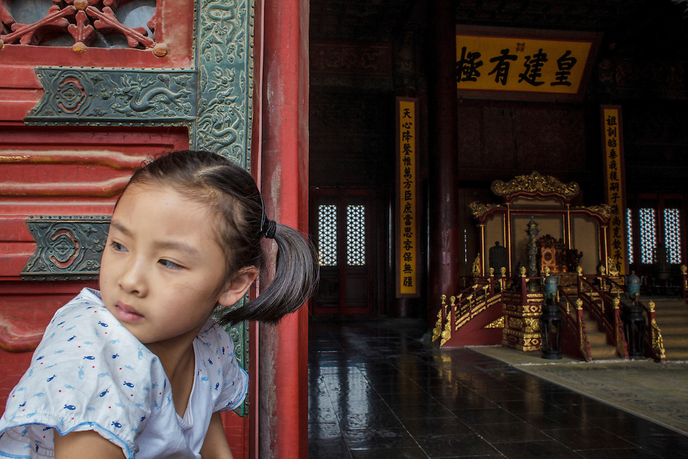A girl near the Emperors Room at the Forbidden City.