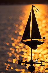 North America, United States, Washington, Kirkland, sailboat weathervane and sparkling lake