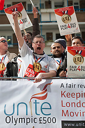 © licensed to London News Pictures. London, UK 16/05/2012. Off duty bus drivers protesting in an open-top bus as part of a Unite the Union campaign for an extra £500 Olympic payment for each bus driver, outside TfL HQ in central London, this morning (16/05/12). Photo credit: Tolga Akmen/LNP