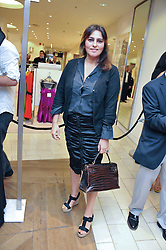 SOLANGE AZAGURY PARTRIDGE at a preview of the new Holmes & Yang fashion collection at Harvey Nichols, London on 6th July 2011.