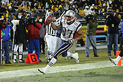 PITTSBURGH - JANUARY 23:  Wide receiver David Givens #87 of the New England Patriots scores a touchdown on a 9 yard catch in the second quarter against the Pittsburgh Steelers during the AFC Championship game at Heinz Field on January 23, 2005 in Pittsburgh, Pennsylvania. The Pats defeated the Steelers 41-27. ©Paul Anthony Spinelli  *** Local Caption *** David Givens