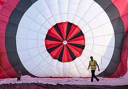 © Licensed to London News Pictures. 29/07/2019; Bristol, UK. Press preview flight for the 41st Bristol International Balloon Fiesta 2019 which will take place from 08 - 11 August 2019. Pilot Craig Thompson for Ben's Tiles Balloons checks inside the balloon envelope before take off. For the preview up to 25 hot air balloons will take off from Filton Airfield, next to the Brabazon Hangar which is the site of a proposed new YTL Arena, and Aerospace Bristol to play homage to the 50th anniversary of Concorde. The Bristol International Balloon Fiesta attracts hundreds of thousands of visitors and this year the Fiesta will be celebrating Icons of Bristol and look to highlight some of the things that make up the home of the International Balloon Fiesta. The event has joined forces with Aerospace Bristol to honour one of the city's most famed creations, Concorde and Aardman Animations who are celebrating the 30th anniversary of Wallace and Gromit. Over the course of four days, the Bristol International Balloon Fiesta will play host to more than 100 colourful hot air balloons of all sizes and shapes. Special shapes are an iconic part of the Fiesta and the event kicks off with its now traditional special shapes launch on Thursday evening of 08 August. Photo credit: Simon Chapman/LNP.