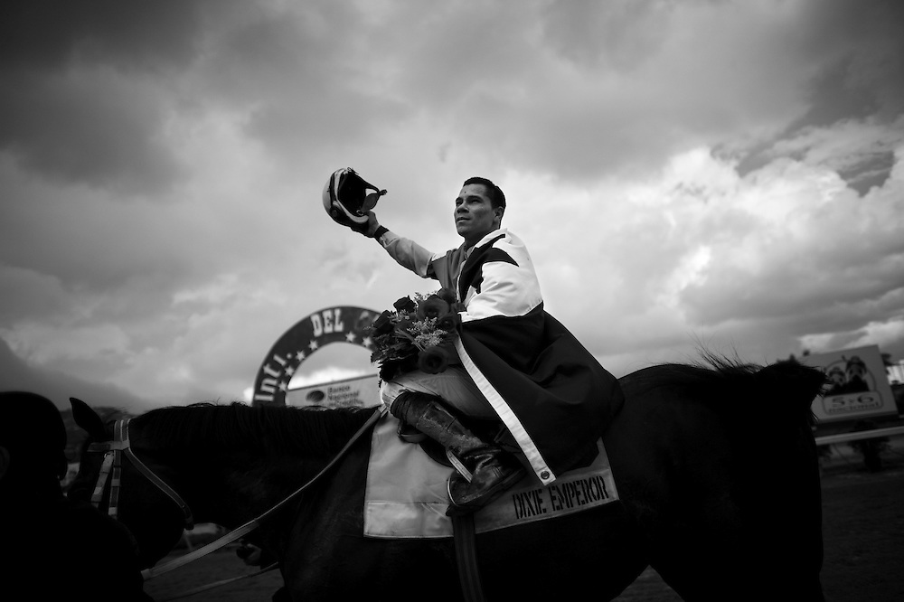 In this photo taken Dec. 5, 2010, Panamenian jockey Lorenzo Lezcano gestures to the public after he won a race during Caribbean Classic Series at the Rinconada racetrack in Caracas, Venezuela.