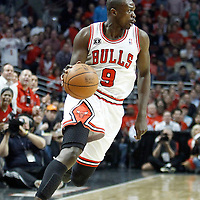 18 May 2011: Chicago Bulls small forward Luol Deng (9) brings the ball upcourt during the Miami Heat 85-75 victory over the Chicago Bulls, during game 2 of the Eastern Conference finals at the United Center, Chicago, Illinois, USA.