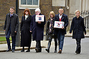 © Licensed to London News Pictures. 28/03/2013. Westminster, UK. (Left - right) John Leech MP, Ann Thornber, Adrian Thornber, Jane Lawton, Nick Lawton, Shauneen Lambe. Two families, whose 17-years-old sons both committed suicide after being arrested, have joined forces to deliver a petition to Downing Street calling for the law to be changed to protect all children in custody. Nick and Jane Lawton's son Joe took his own life just two days after being arrested for failing a breath test. Adrian and Ann Thornber lost their son Edward after he was wrongly sent a letter to attend court instead of a warning after being caught with 50p worth of cannabis. In both cases the parents had not been informed of the arrest.. Photo credit : Stephen Simpson/LNP