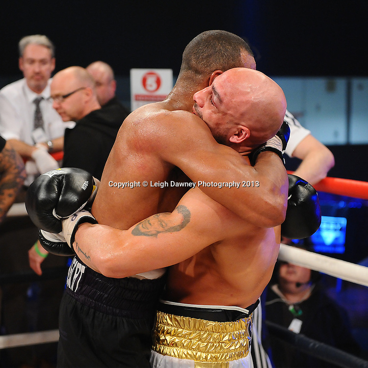 Bob Ajisafe (left) commends Dean Francis for his effort after defeating him for the Vacant British Light Heavyweight Title on 15th March 2014 at the Rivermead Leisure Centre, Reading, Berkshire. Promoted by Hennessy Sports. © Leigh Dawney Photography 2014.
