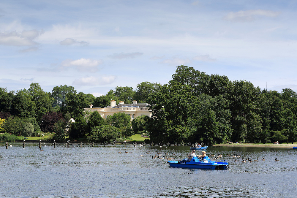People in a pedalo on the Boating Lake in Regent's Park, one of London's Royal Parks