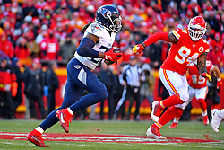Jan 19, 2020; Kansas City, Missouri, USA; Tennessee Titans running back Derrick Henry (22) runs the ball against Kansas City Chiefs outside linebacker Terrell Suggs (94) during the first half in the AFC Championship Game at Arrowhead Stadium. Mandatory Credit: Denny Medley-USA TODAY Sports