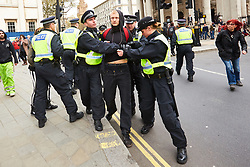 © Licensed to London News Pictures. 01/04/2017. LONDON, UK.  EDL and Britain First protest march through central London. The Met police imposed conditions on the protest and a counter protest in the expectation of serious disorder.  In this picture: Police arresting an anti-fascist protester.   Photo credit: Cliff Hide/LNP