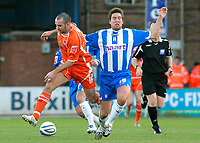 Photo: Tom Dulat/Sportsbeat Images.<br /> <br /> Colchester United v Blackpool. The FA Barclays Premiership. 29/12/2007. <br /> <br /> Gary Taylor Fletcher of Blackpool and Adam Virgo of Colchester United with the ball.