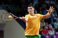 Bernard Tomic from Australia in action during the BNP Paribas Davis Cup 2013 between Poland and Australia at Torwar Hall in Warsaw on September 15, 2013.<br /> <br /> Poland, Warsaw, September 15, 2013<br /> <br /> Picture also available in RAW (NEF) or TIFF format on special request.<br /> <br /> For editorial use only. Any commercial or promotional use requires permission.<br /> <br /> Photo by © Adam Nurkiewicz / Mediasport