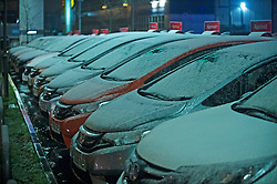 © Licensed to London News Pictures. 22/01/2019. Orpington, UK. Snow on cars at a Honda dealership in Orpington. The big freeze hits South East London as snow falls tonight with temperatures to drop to -12C.Photo credit: Grant Falvey/LNP
