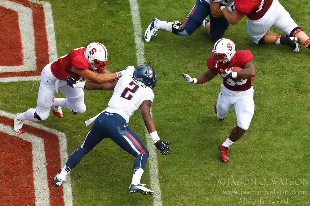 PALO ALTO, CA - OCTOBER 06: Running back Stepfan Taylor #33 of the Stanford Cardinal rushes past safety Marquis Flowers #2 of the Arizona Wildcats during the first quarter at Stanford Stadium on October 6, 2012 in Palo Alto, California. The Stanford Cardinal defeated the Arizona Wildcats 54-48 in overtime. (Photo by Jason O. Watson/Getty Images) *** Local Caption *** Stepfan Taylor; Marquis Flowers