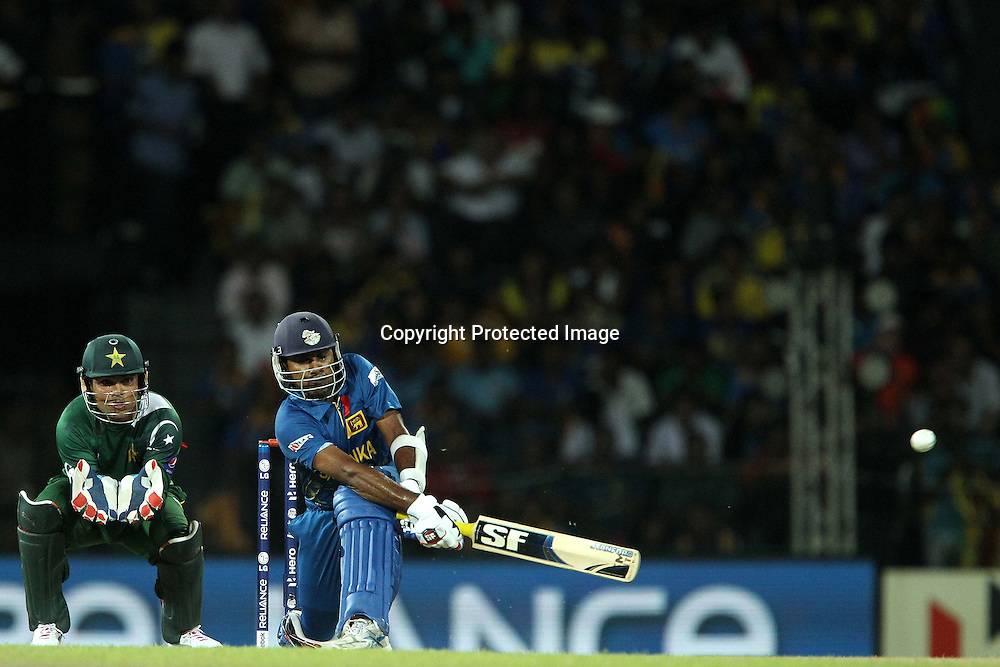 Tilakaratne Dilshan sweeps a delivery from Raza Hasan for four during the ICC World Twenty20 semi final match between Sri Lanka and Pakistan held at the Premadasa Stadium in Colombo, Sri Lanka on the 4th October 2012<br /> <br /> Photo by Ron Gaunt/SPORTZPICS