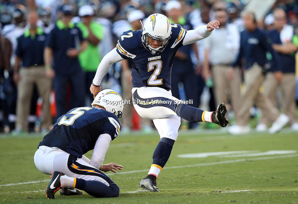 San Diego Chargers punter Mike Scifres (5) holds while San Diego Chargers kicker Josh Lambo (2) kicks a 20 yard field goal that cuts the Seattle Seahawks second quarter lead to 7-6 during the 2015 NFL preseason football game against the Seattle Seahawks on Saturday, Aug. 29, 2015 in San Diego. The Seahawks won the game 16-15. (©Paul Anthony Spinelli)