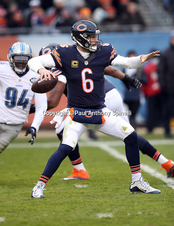 Chicago Bears quarterback Jay Cutler (6) drops throws a first down pass in the second quarter while being pressured from behind by Detroit Lions defensive end Ezekiel Ansah (94) during the NFL week 17 regular season football game against the Detroit Lions on Sunday, Jan. 3, 2016 in Chicago. The Lions won the game 24-20. (©Paul Anthony Spinelli)