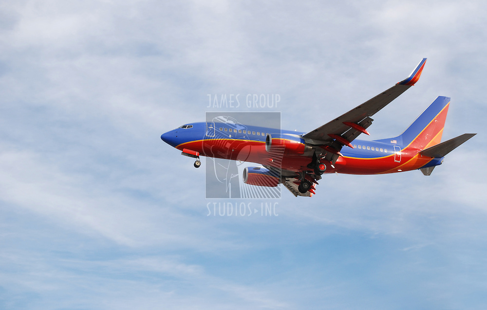 Colorful passenger jet with landing gear down