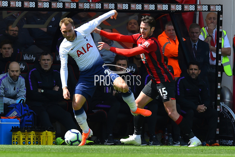 Christian Eriksen (23) of Tottenham Hotspur battles for possession with Adam Smith (15) of AFC Bournemouth during the Premier League match between Bournemouth and Tottenham Hotspur at the Vitality Stadium, Bournemouth, England on 4 May 2019.