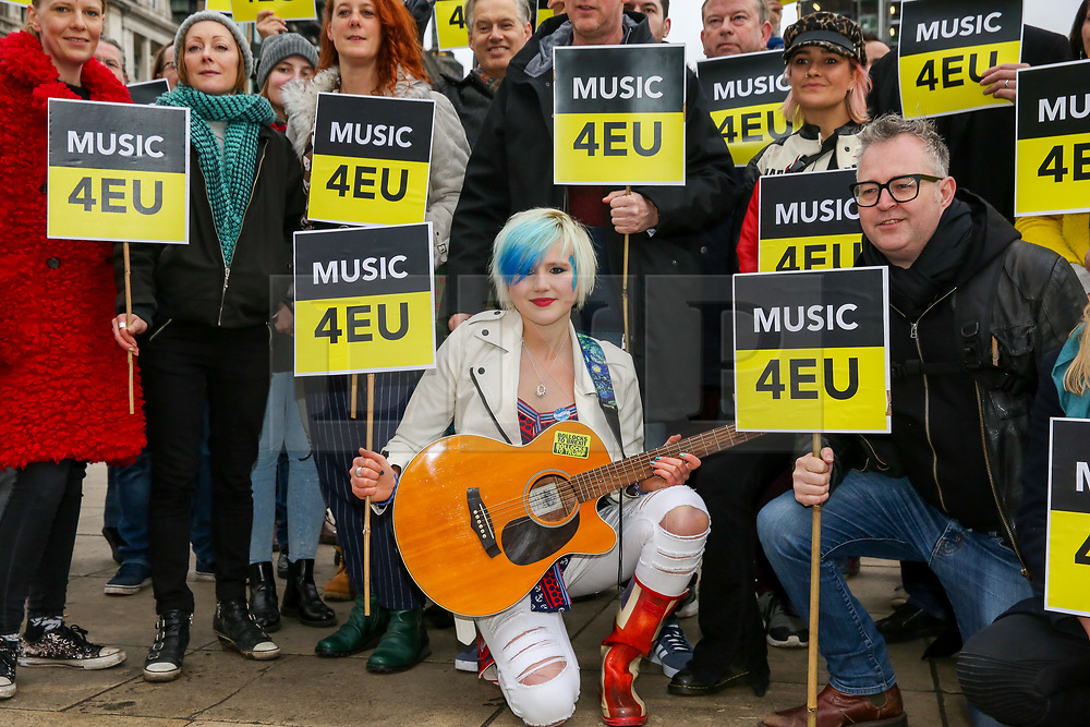 © Licensed to London News Pictures. 12/01/2019. London, UK. Members of UK music industry poses outside Houses of Parliament before marching to Downing Street to hand a Brexit petition.<br /> A petition signed by musicians, artists, producers, managers and businesses from across the music industry in the UK to the Prime Minister, expressing the concerns over Brexit and the current direction of the UK's proposed departure from the EU for the music industry.. Photo credit: Dinendra Haria/LNP