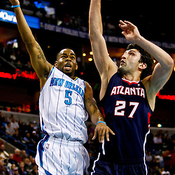 December 26, 2010; New Orleans, LA, USA; New Orleans Hornets guard Marcus Thornton (5) shoots over Atlanta Hawks center Zaza Pachulia (27) during the first quarter at the New Orleans Arena.  Mandatory Credit: Derick E. Hingle