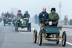 © Licensed to London News Pictures. 01/11/2015. London, UK. Drivers in vintage cars cross Westminster Bridge in foggy conditions during the Bonhams London to Brighton Veteran Car Run.  This year's event celebrates the 119th anniversary of the very first Run. Photo credit : Stephen Chung/LNP
