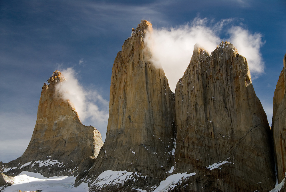 Morning clouds clinging to the granite of Torres Del Paine, Torres Del Paine National Park, Chile.