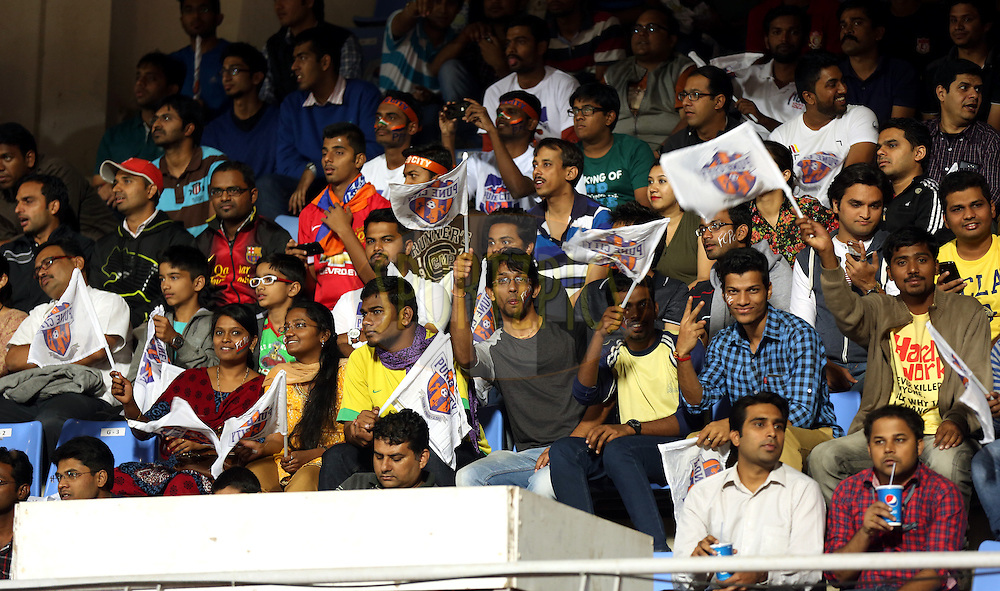 Fan's enjoy's during match 17 of the Hero Indian Super League between FC Pune City and Kerala Blasters FC held at the Shree Shiv Chhatrapati Sports Complex Stadium, Pune, India on the 30th October 2014.<br /> <br /> Photo by:  Sandeep Shetty/ ISL/ SPORTZPICS