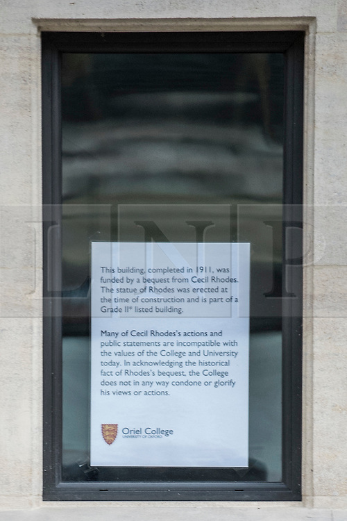 © Licensed to London News Pictures. 13/01/2016. Oriels College, Oxford. A notice in a window at Oxford University close to a Cecil Rhodes statue at Oriel College. There is a campaign to remove the statue of Cecil Rhodes from the front of Oriel College by a group calling themselves Rhodes must fall. Photo credit : Mark Hemsworth/LNP