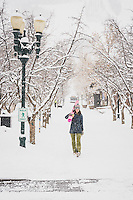 Janelle Huelsman makes her morning commute through downtown Aspen on her way to the Gondola at Aspen Mountain, Colorado.