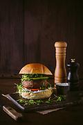 lamb burger on cutting board