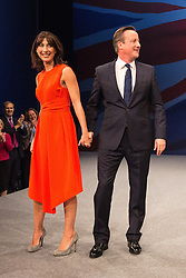 © Licensed to London News Pictures . 07/10/2015 . Manchester , UK . Prime Minister DAVID CAMERON and his wife SAMANTHA CAMERON on the stage after the leader's speech . The Conservative Party Conference at the Manchester Central Convention Centre . Photo credit : Joel Goodman/LNP