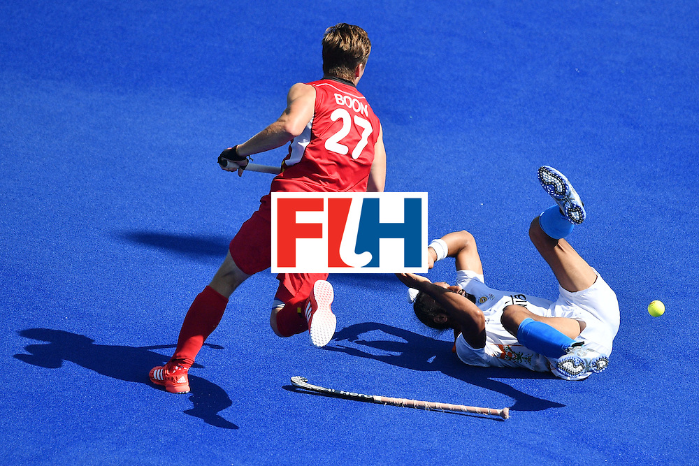 India's Akashdeep Singh (R) falls on the pitch beside Belgium's Tom Boon during the men's quarterfinal field hockey Belgium vs India match of the Rio 2016 Olympics Games at the Olympic Hockey Centre in Rio de Janeiro on August 14, 2016. / AFP / Carl DE SOUZA        (Photo credit should read CARL DE SOUZA/AFP/Getty Images)