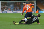 York City midfielder James Barrett tackles Luton Town midfielder Luke Guttridge  during the Sky Bet League 2 match between Luton Town and York City at Kenilworth Road, Luton, England on 10 October 2015. Photo by Simon Davies.