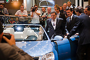 The 61. IAA (Internationale Autoausstellung) 2005 is one of the World's biggest trade fairs of the automotive industry..Volkswagen Eos cabriolet. Sceptical Chancellor Gerhard Schröder.
