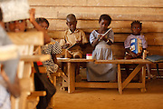 Children attend class at the Podio primary school in the village of Podio, Bas-Sassandra region, Cote d'Ivoire on Friday March 2, 2012.