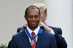 U.S. President Donald Trump presents golf legend Tiger Woods with the nation's highest civilian honor, the Presidential Medal of Freedom during a ceremony in the Rose Garden at the White House, May 6, 2019 in Washington, DC. Photo by Olivier Douliery/ABACAPRESS.COM