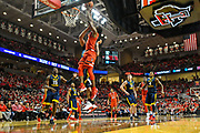 LUBBOCK, TX - JANUARY 13: Keenan Evans #12 of the Texas Tech Red Raiders goes up for the dunk against Esa Ahmad #23 of the West Virginia Mountaineers during the game on January 13, 2018 at United Supermarket Arena in Lubbock, Texas. Texas Tech defeated West Virginia 72-71. (Photo by John Weast/Getty Images) *** Local Caption *** Keenan Evans;Esa Ahmad