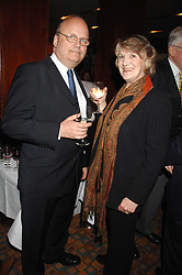 COUNT ANDREI TOLSTOY-MILOSLAVSKY and MRS DAVID BOWEN-JONES at a party for Countess Carolinda Tolstoy-Miloslavsky held at The Arts Club, 40 Dover Street, London on 15th April 2008.<br />