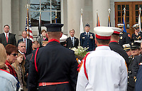 Congressman Frank Guinta, Congressman Charlie Bass, Senator Jeanne Shaheen, Governor John Lynch, Major General William N, Reddell III, Chief Kevin J. Breen watch from the steps of the State House as the New Hampshire Fire Service Honor Guard lay the Fire Service Wreath during the 10 Year Observance of September 11th ceremony Sunday morning.  (Karen Bobotas/for the Concord Monitor)