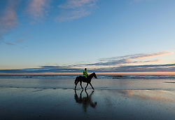 © Licensed to London News Pictures. <br /> 07/04/2017<br /> Saltburn-by-the-Sea, UK. <br />  <br /> A horse and rider take an early morning ride out on the beach at Saltburn-by-the-Sea in North Yorkshire. <br /> <br /> <br /> Photo credit: Ian Forsyth/LNP