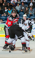 KELOWNA, CANADA - OCTOBER 3:  Myles Bell #29 of the Kelowna Rockets checks a Vancouver Giants player at the Kelowna Rockets on October 3, 2012 at Prospera Place in Kelowna, British Columbia, Canada (Photo by Marissa Baecker/Getty Images) *** Local Caption *** Myles Bell;