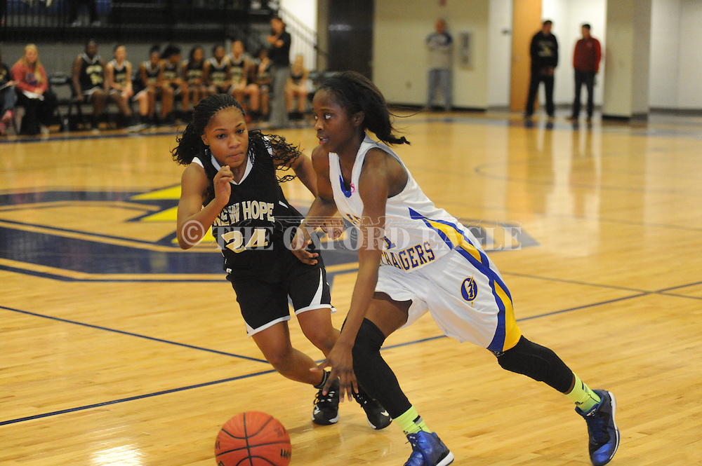 Oxford High's Tiara King (1) dribbles up court against New Hope's Alaysha Jennings (24) in Oxford, Miss. on Friday, February 6, 2015. Oxford won.