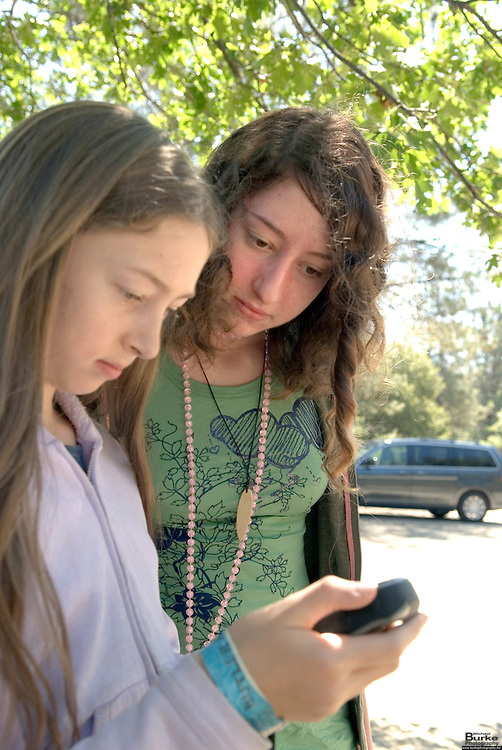 Geocaching has become a popular family activity for residents of the north state.  Shirley Goldstein of Redding and her daughters Cierra (brown hair in green), 15, and Bryce (long hair in white), 12 are looking for a stash at the Pioneer Baby Grave site on 299 West just west of the town of Shasta.