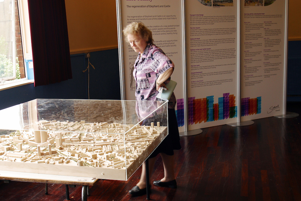 A resident from the Heygate estate views an architect model for the propsed redevelopment of the Elephant and Castle in south London.