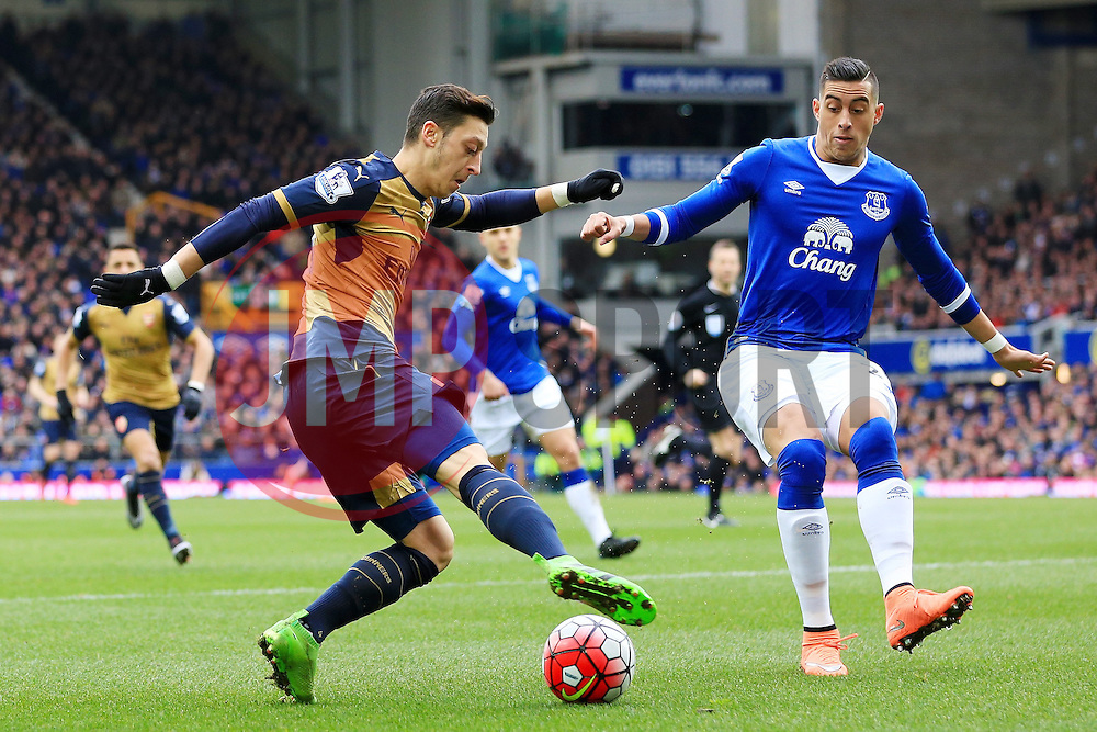 Arsenal's Mesut Ozil takes on Everton's Ramiro Funes Mori  - Mandatory byline: Matt McNulty/JMP - 19/03/2016 - FOOTBALL - Goodison Park - Liverpool, England - Everton v Arsenal - Barclays Premier League