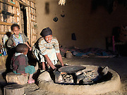 Meseret Assefa, Age 27, lights the fire in her home in Kotoba, Ethiopia. Meseret is in Mesoman Bedatu Group. She is married to Assefa Dinka and they have three children: Getu Assefa(M), AGE 8 years old, Chaltu Assefa(F), age 5 years old, and Ogari Assefa(M), age 2 years old.