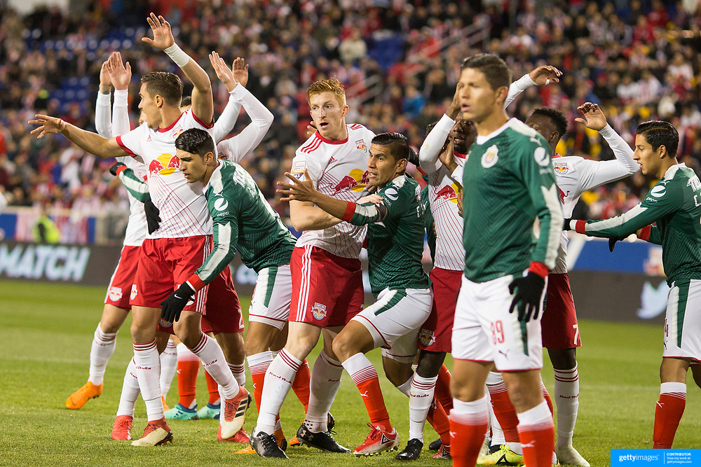 HARRISON, NEW JERSEY- APRIL 10:  Tim Parker #26 of New York Red Bulls and Carlos Salcido #3 of C.D. Guadalajara jostle for position as players prepare for a free kick during the New York Red Bulls Vs C.D. Guadalajara CONCACAF Champions League Semi-final 2nd leg match at Red Bull Arena on April 10, 2018 in Harrison, New Jersey. (Photo by Tim Clayton/Corbis via Getty Images)