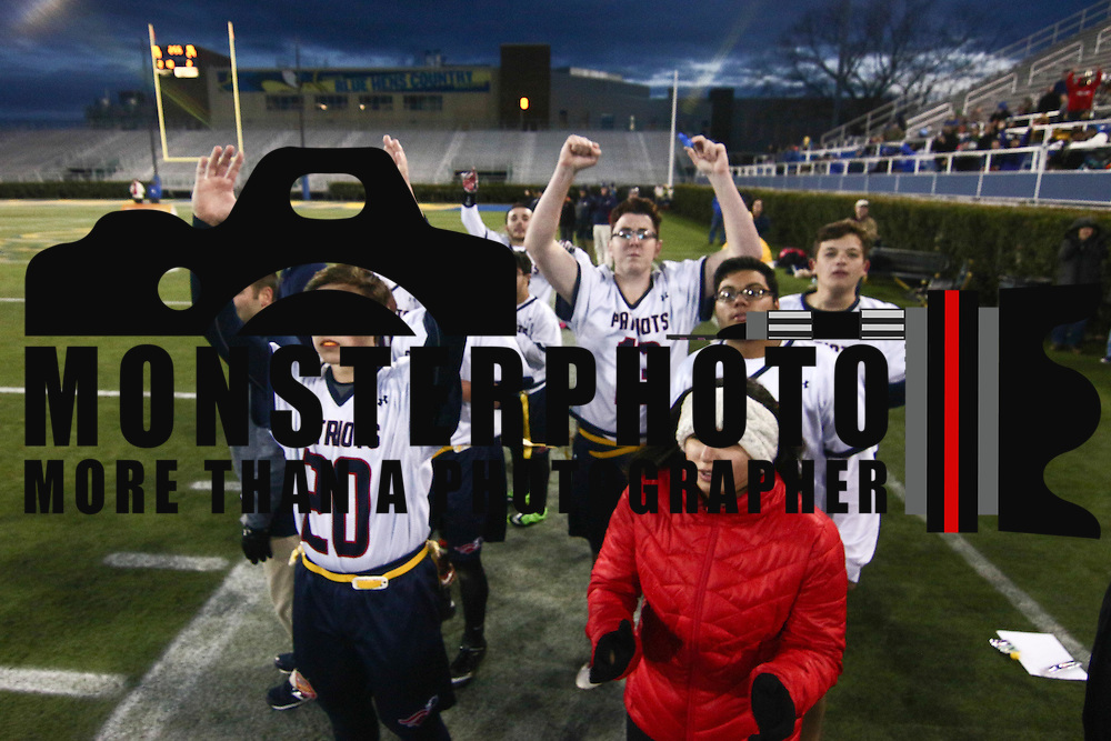 Benjamin	Scannell signals town down from the sidelines on scoring after touch down pass during the inaugural Special Olympics DIAA Unified Flag Football Championship game, Newark Charter defeated McKean 35-28 Saturday, Dec. 03, 2016 at Delaware Stadium in Newark.