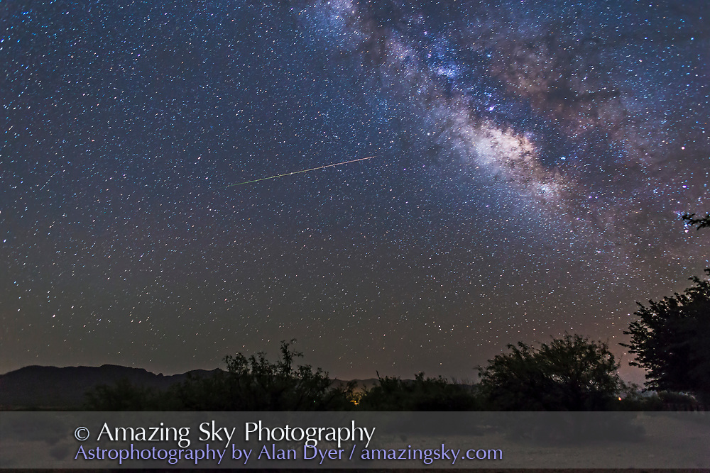An Eta Aquarid meteor streaks out of Aquarius at left toward the Milky Way at right. Note the chnages in colour as the meteor travels from left to right and descends into our atmosphere.<br /> <br /> This is one frame from a set of 600 frames taken as part of a time-lapse of the Milky Way rising, shot from near Portal, Arizona, May 4/5, 2014. This is a 36-second exposure at f/2.5 with the 24mm lens and Canon 6D at ISO 3200.