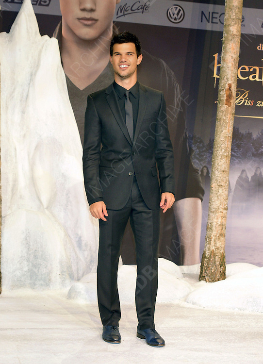 16.NOVEMBER.2012. BERLIN<br /> <br /> TAYLOR LAUTNER ATTENDS THE TWILIGHT SAGA BREAKING DAWN PART 2 GERMANY PREMIERE HELD AT THE CINESTAR IN BERLIN, GERMANY.<br /> <br /> BYLINE: EDBIMAGEARCHIVE.CO.UK<br /> <br /> *THIS IMAGE IS STRICTLY FOR UK NEWSPAPERS AND MAGAZINES ONLY*<br /> *FOR WORLD WIDE SALES AND WEB USE PLEASE CONTACT EDBIMAGEARCHIVE - 0208 954 5968*